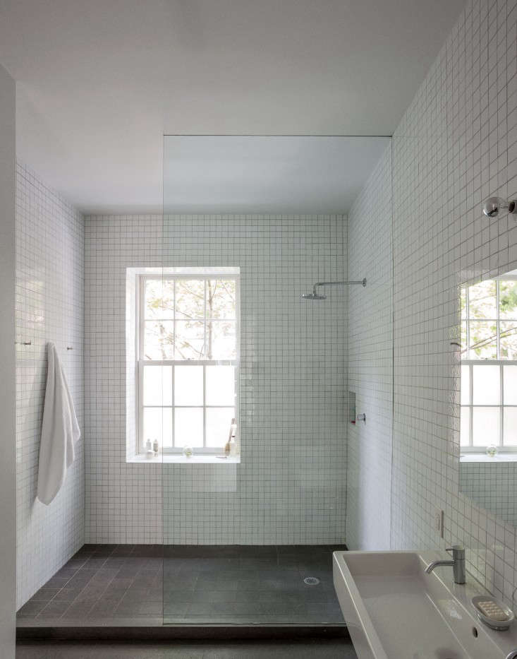 A lot of grout to keep clean, in a floor-to-ceiling tiled shower by the architects behind Solveig Fernlund Design and Neil Logan Architect—though the choice of darker grout will help conceal dirt. See  Favorites: White Bathrooms from the Remodelista Designer Directory for more all-white baths designed by architects.