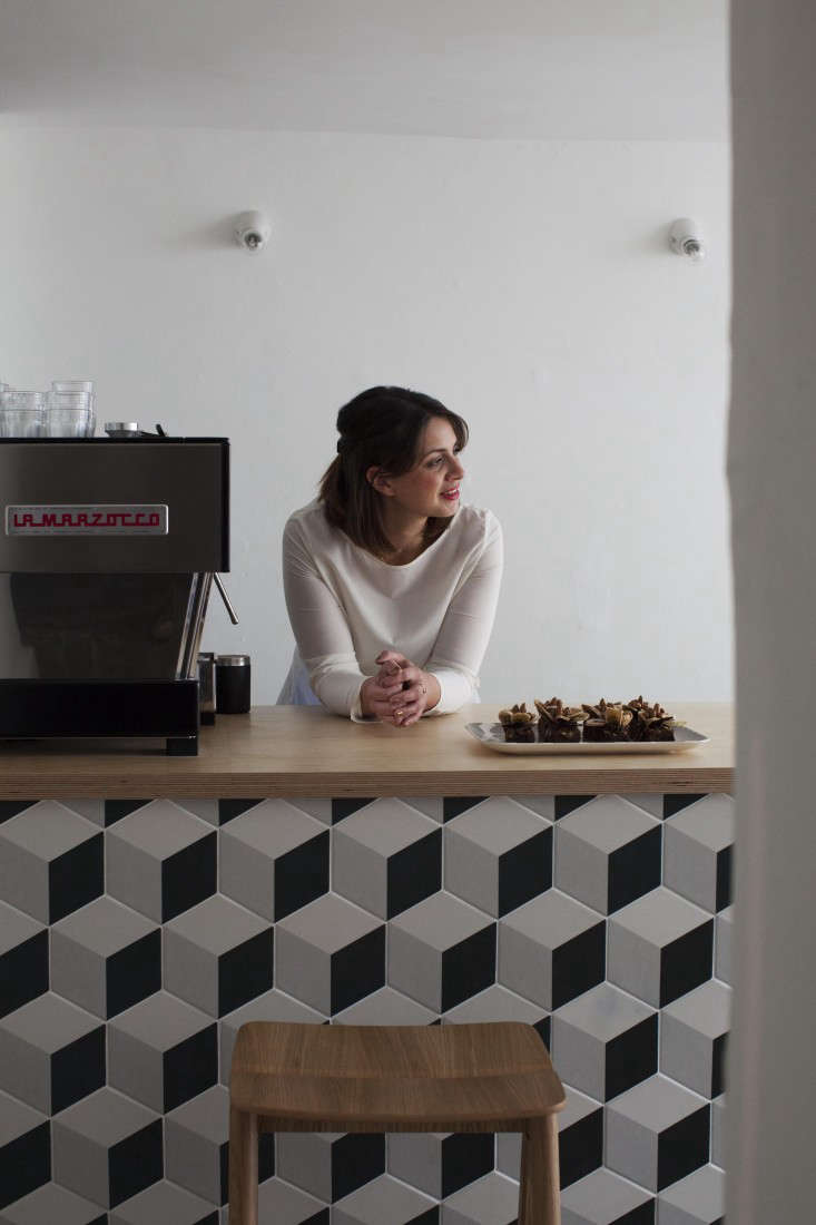 Caro owner,Natalie Jones, behind her counter offering salted-caramel brownies from Somerset artisanal baker The Bakemonger. The counter is clad in Geometric Cube Tiles by Mandarin Stone, and the white Porcelain Ceiling Mounted Fittings are by Thomas Hoof from SCP. Stay tuned: Jones will offer guests a room to rent above the shop later this fall and has a suite in the works for spring. Like the look of her shop? She&#8