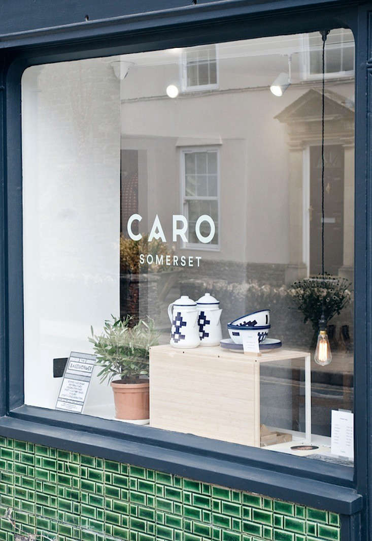 A peek into the shop from a tile-clad window with enamelware by Welsh brand Blodwen on display. Caro occupies three ground-floor rooms in an th-century stone building, and the Victorian green tiles, Jones tells us, were revealed under a layer of cream paint. &#8