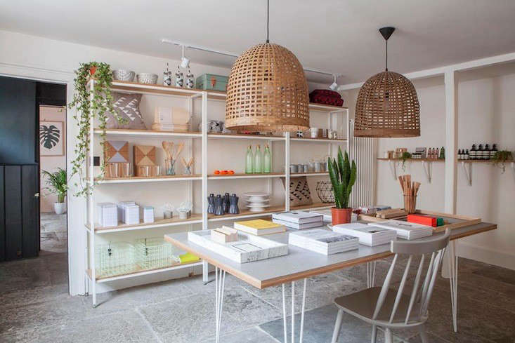 An array of household goods, from wire bins to local ceramics and cushions, are displayed on steel-framed plywood shelves made byPaul Vincent.Reading materials are displayed on a Vincent table with a Forbo Marmoleum top and hairpin legs.