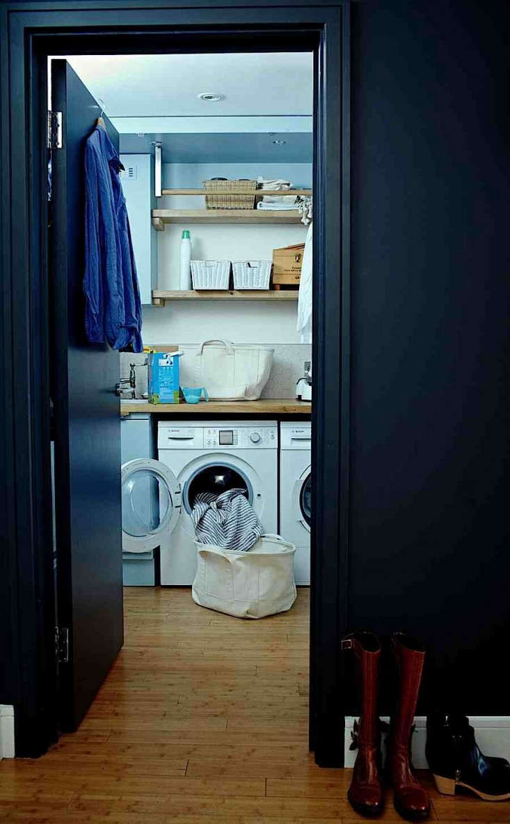 When the doors are opened, the space becomes a full-scale laundry room.