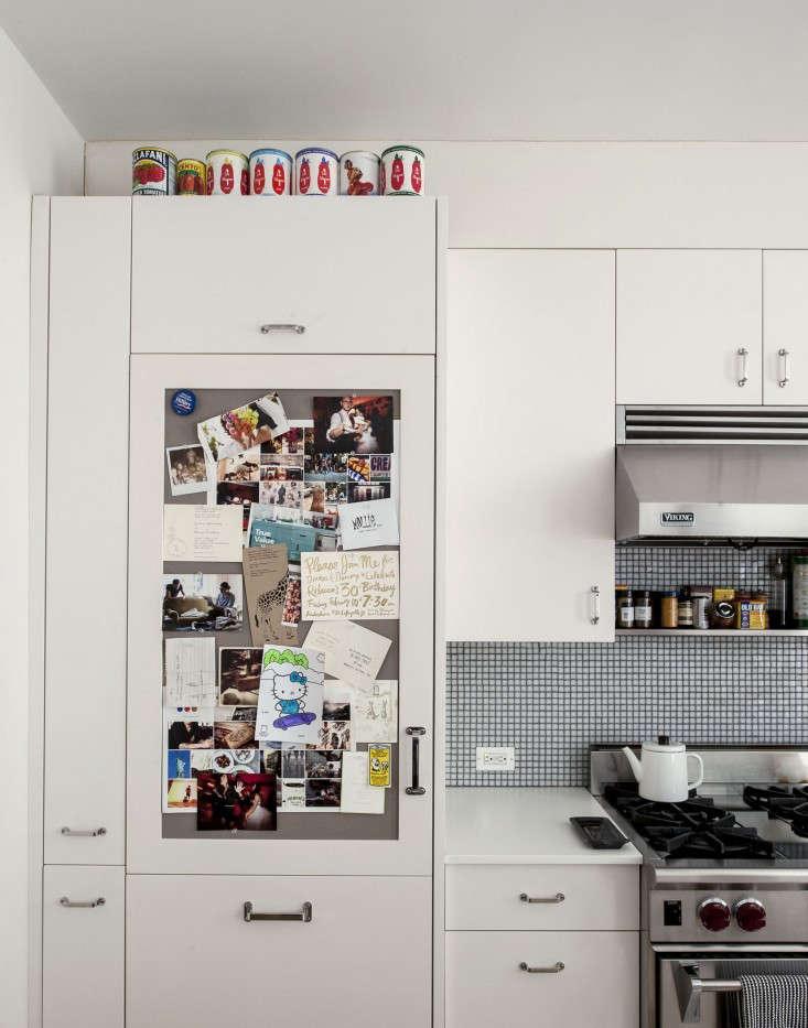 cobble hill duplex by oliver freundlich sub zero with pinboard door remodelista 16