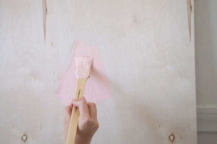 step \1: stand your panel of wood up against a wall on top of a painter&#8\ 12