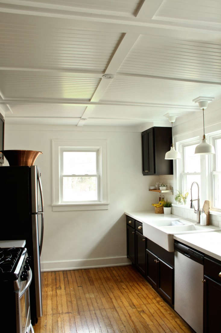 The couple tackled one room at a time, including the ceiling in their newly overhauled kitchen.