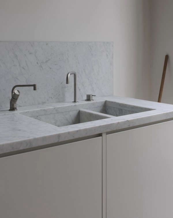 The integrated marble sink. Considering marble for your own kitchen? Get the lowdown inRemodeling src=