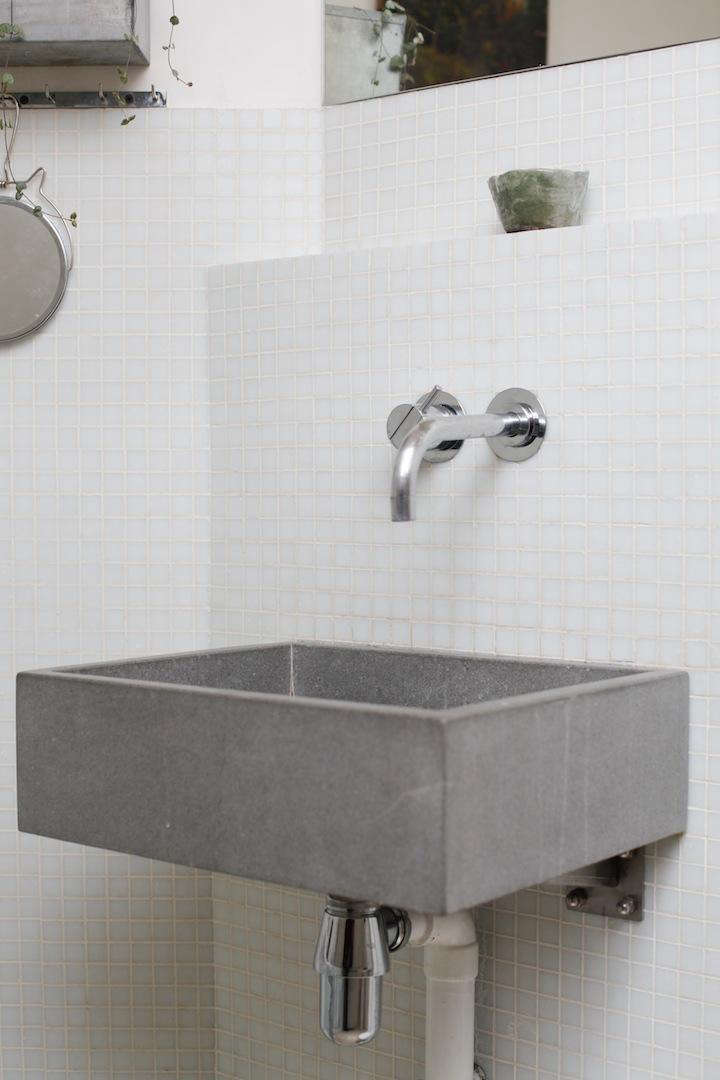 A simple concrete sink in the Paris apartment of an architect and an artist; see At Home with an Artful Couple in the South of Paris for more.