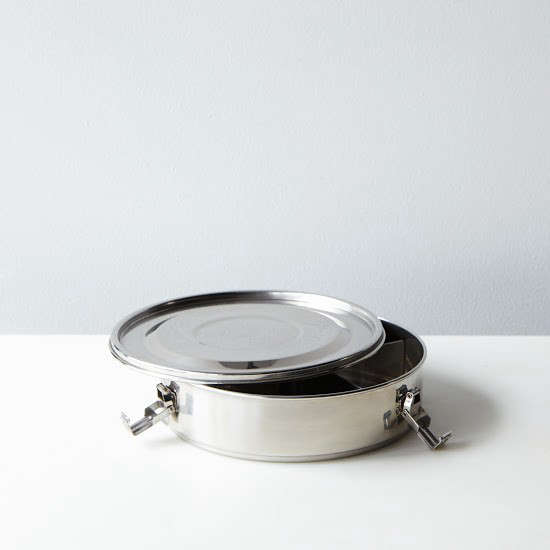 A tiffin spin-off, the stainless-steelDivided Airtight Container has four compartments and is 7 5/8 inches in diameter;$30 from Food5