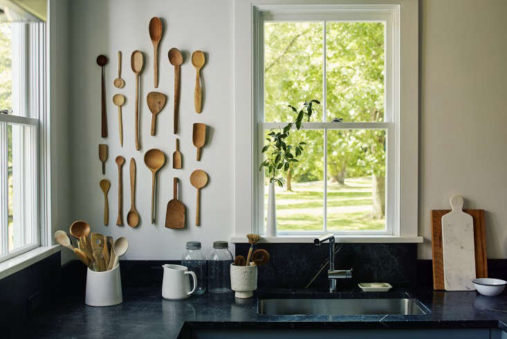 Dunja loves displaying collections—she contemplated hanging antique dentures over her bed and silver faux antlers in the dining room, ideas that Whitman nixed. The kitchen&#8