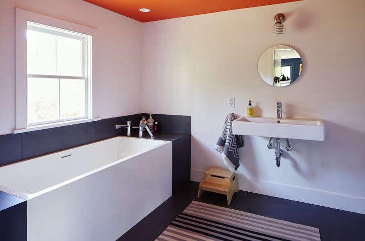in the bath ofan\1880s farmhouse in upstate new york, a monochrome rug bala 16