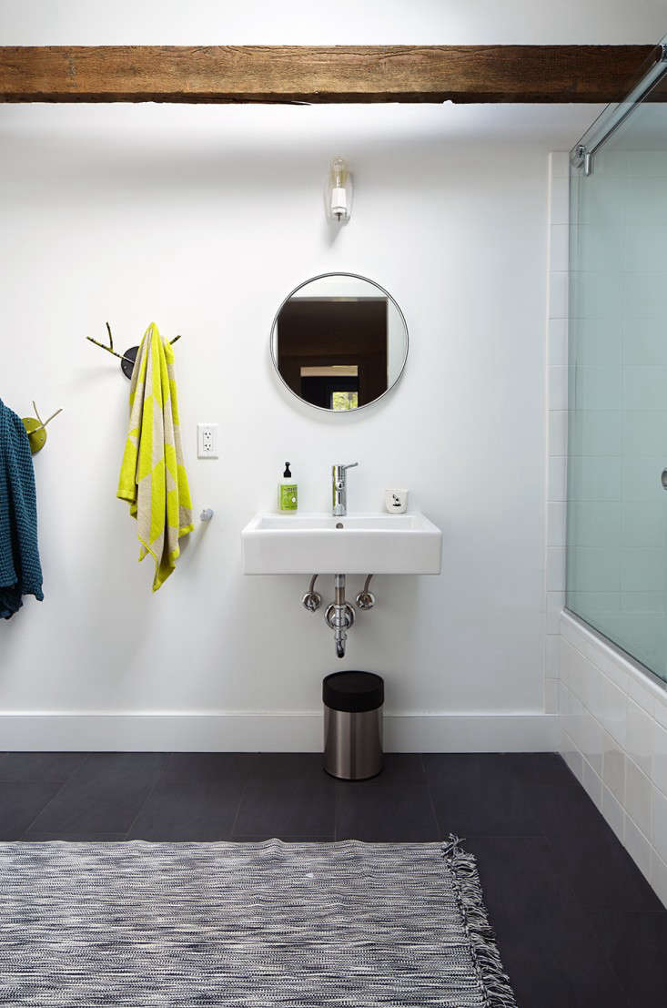 The sink is a Duravit Vero Washbasin. The striped mirror light is from Schoolhouse Electric.