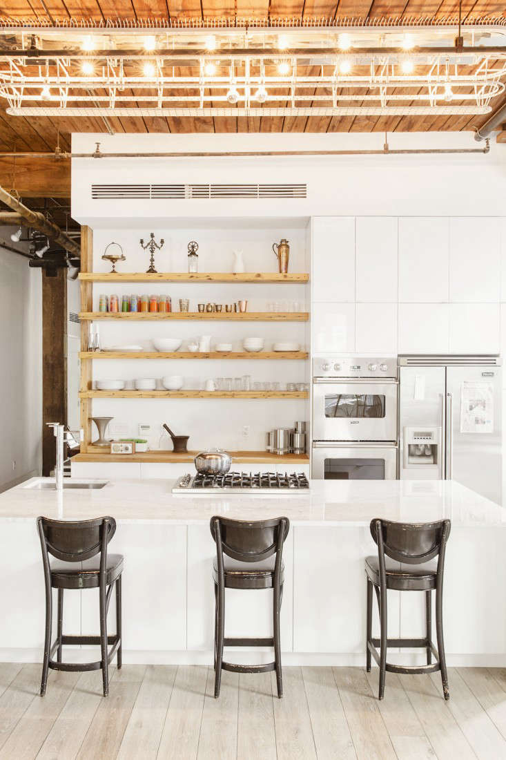 a carrara marble topped kitchen island anchors the space while ikea cabinets re 9