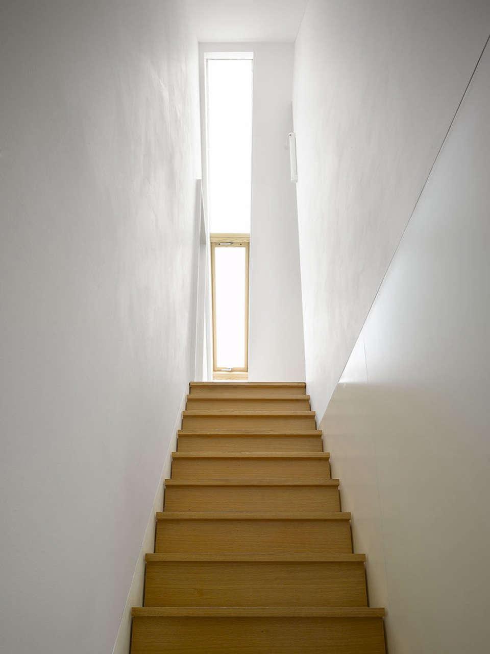 Family House   105  n  106   Prague Studio pha white stairwell wood stairs