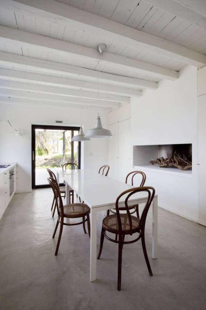 a minimalist fireplace and bentwood chairs add warmth to the dining area. 11