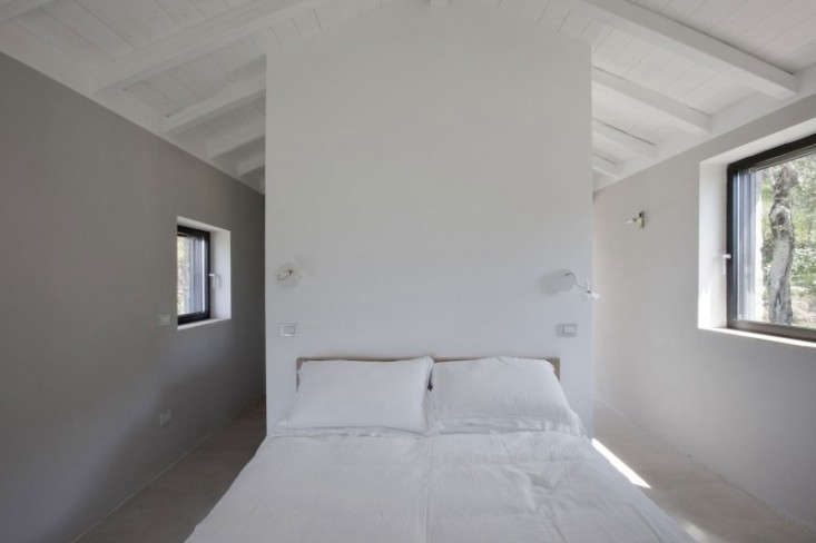 a sanctuary in the summer months: a pale bedroom with white linens. 13