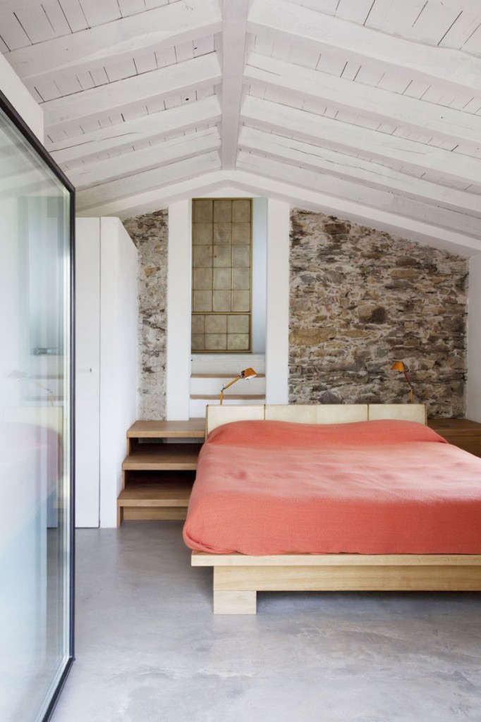 an original stone wall contrasts with the new structural elements. 16