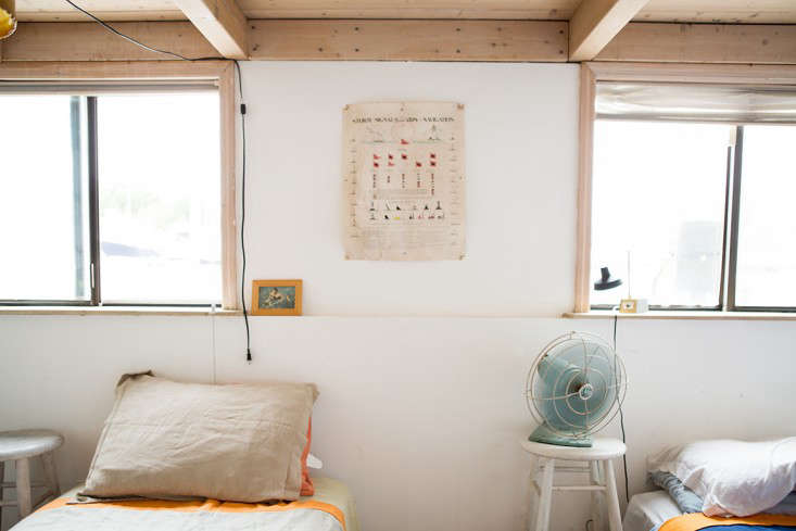 Rehab Diary The Ultimate Houseboat in NYC A nautical poster tacked to the wall.