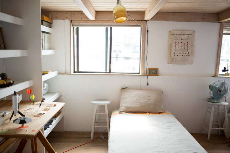 Rehab Diary The Ultimate Houseboat in NYC The additional three bunks are below deck. This one has a ceiling light made from a beeswax dipped glass jug with the bottom cut off.
