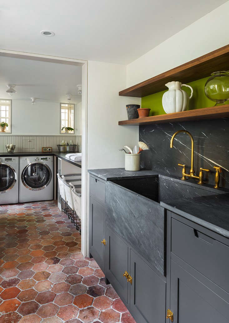 An expansive laundry room has space for side-by-side units, plus a row of rolling canvas hampers. See The Architect Is In: A Brooklyn Brownstone Transformed, with Respect for more.