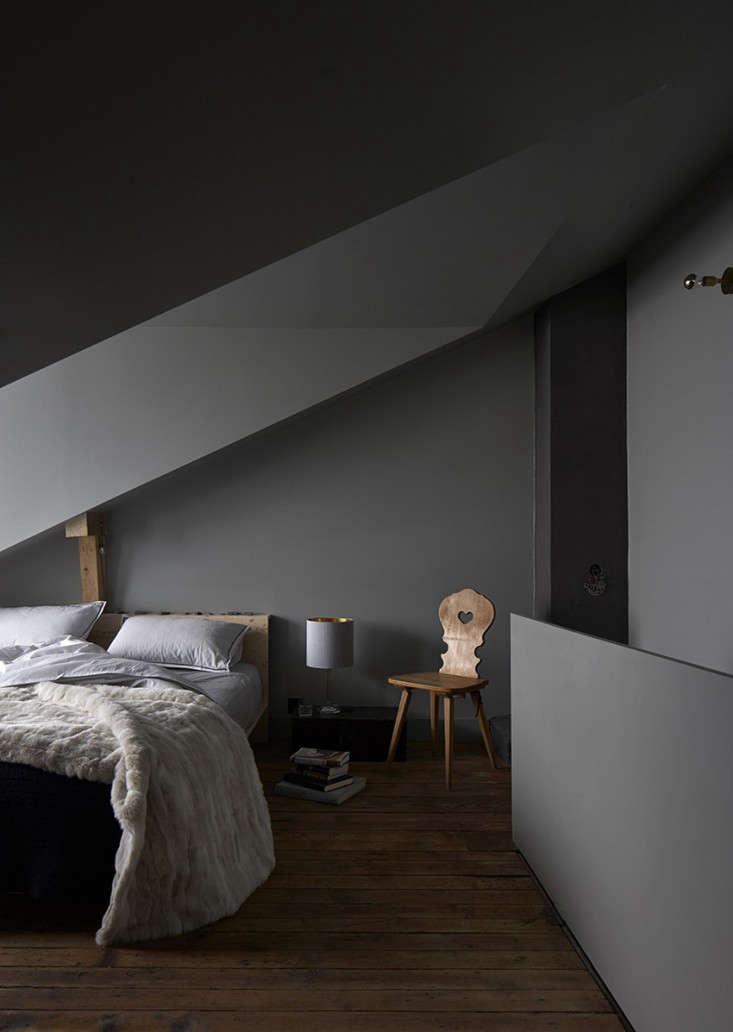The under-the-eaves master bedroom has a bed that&#8