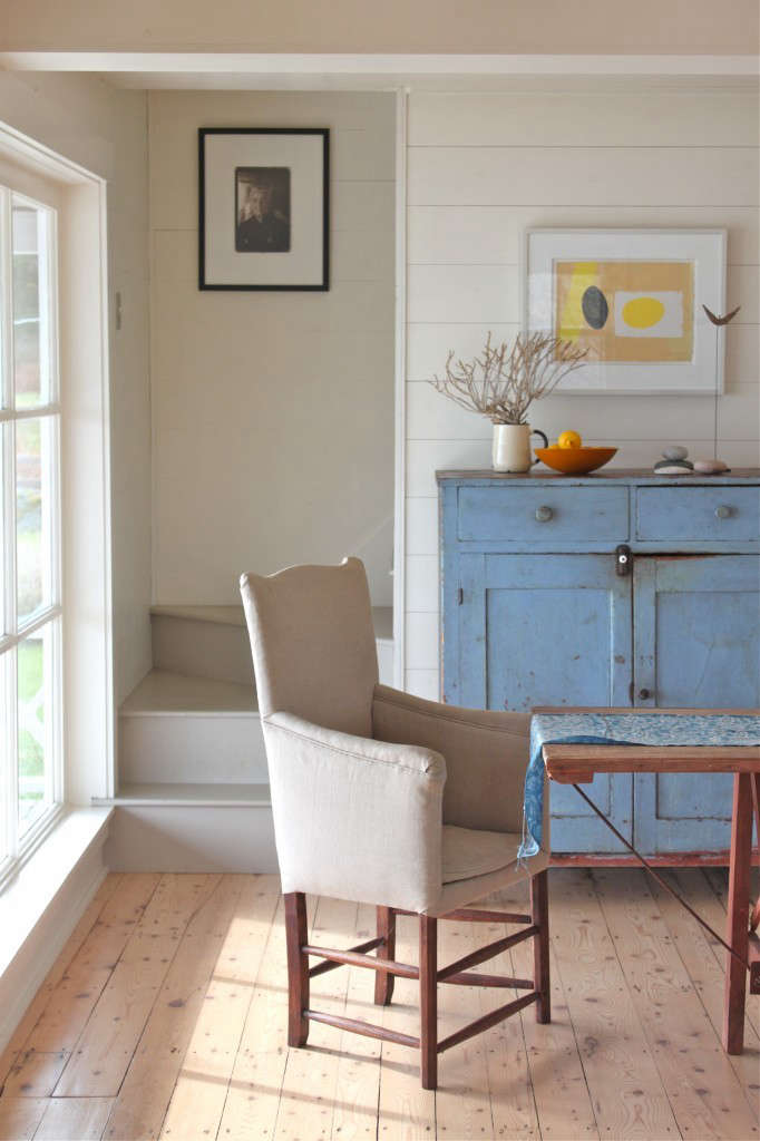a faded dining room cabinet ina cottage reborn in coastal maine. photograph b 13