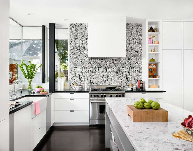 in a kitchen designed by architect hugh randolph, a stove wall backsplash is ma 14