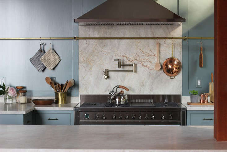 Another kitchen designed by Jersey Ice Cream Co. with an even longer brass rail that crosses over a marble backsplash fromBuilding Character: Jersey Ice Cream Co. and the Case of the Charmless Manse.