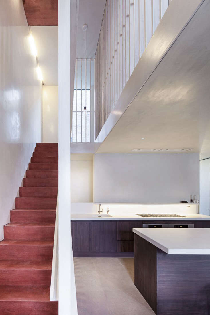 jonathan tuckey ex submariner's house red pigment concrete stairs london remode 12