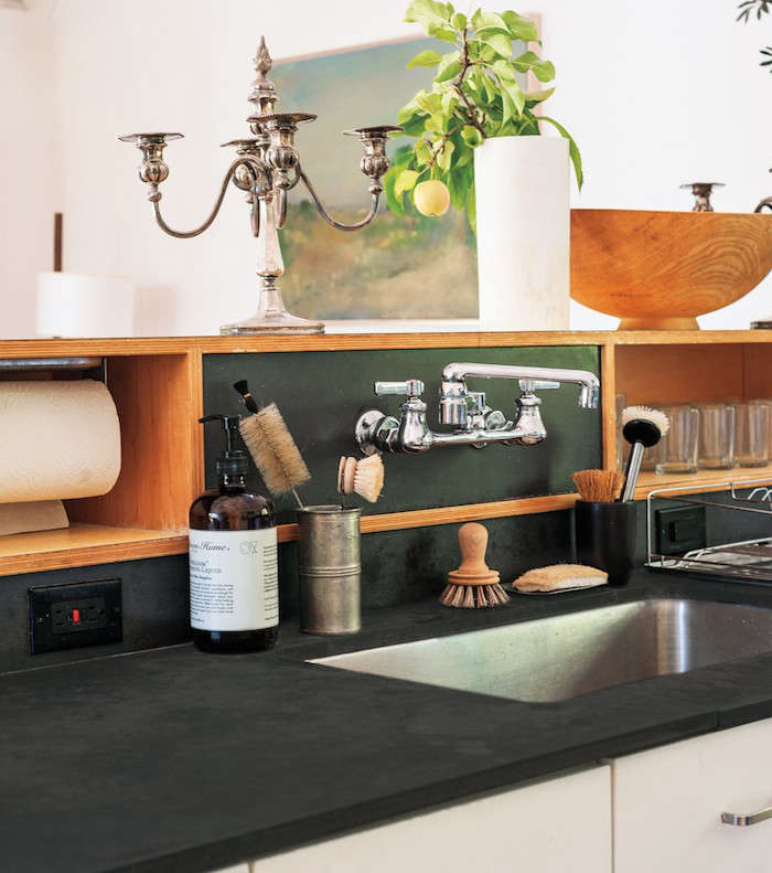 Black outlets are mounted horizontally on either side of the sink in Remodelista editor in chief Julie&#8