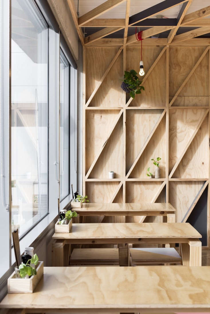 No-frills plywood tables (and shelving) in Melbourne. See Jury: A Cafe in a Converted Prison.