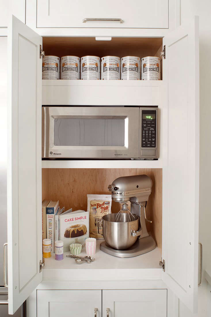 Alison Davin of design firm Jute(a member of the Remodelista Architect & Designer Directory) tucked a microwave in a kitchen cabinet; see the whole project at Rehab Diary: A Small-Kitchen Makeover with Maximum Storage. Photograph by Drew Kelly.