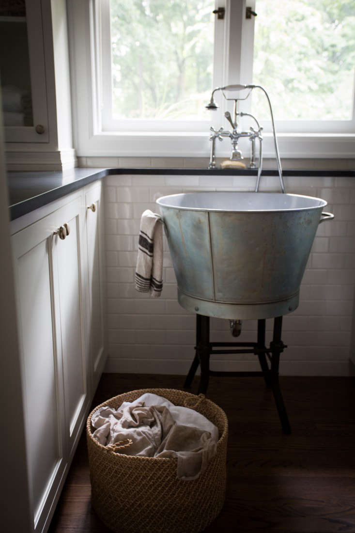 In the Michigan home of a designer and blogger, a zinc washbasin is a small-space solution for washing delicates. See Pattern Language: A Textiles Enthusiast at Home in Ann Arbor.