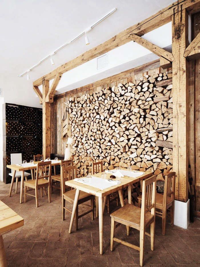 a full wall of stacked firewood at lacrimi si sfinti restaurant in bucharest, r 13