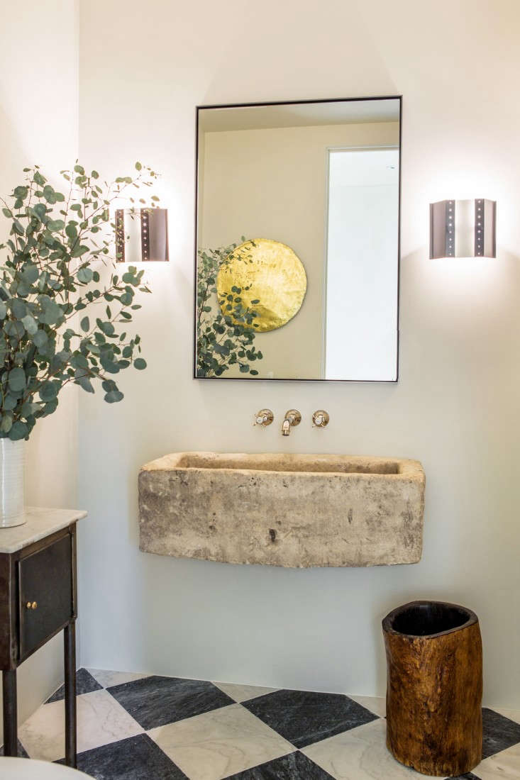 In a house designed by Leigh Herzig, a limestone trough sink sourced from Big Daddy&#8