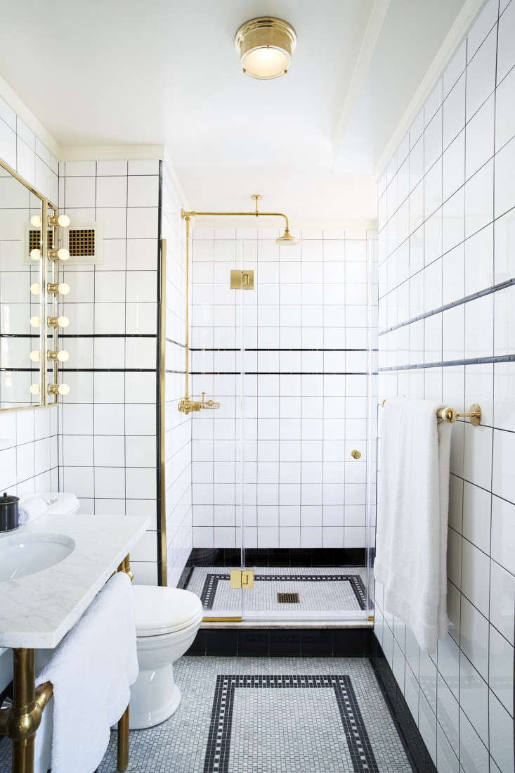 Exposed brass shower fixtures in a clubby New York City hotel. Photograph courtesy of The Ludlow. (For more, see The Ludlow Hotel: Downtown NYC&#8