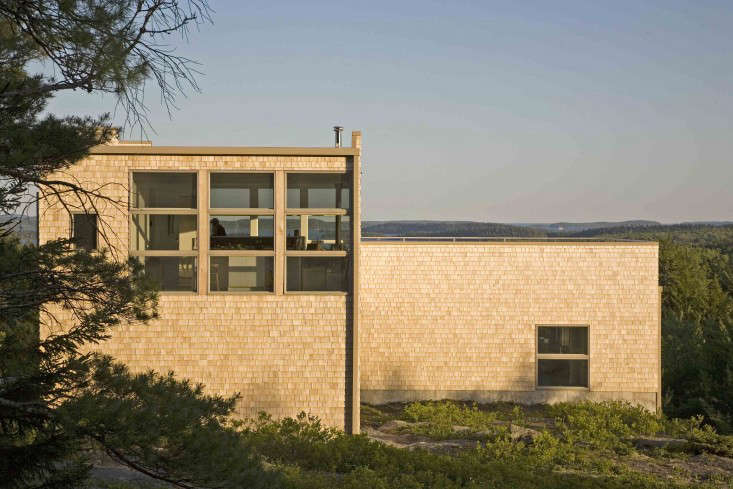 """anew house on a granite outcropping in down east, maine, is """"clad humbly in 17"""