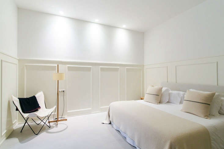 Cream-colored wainscoting at Urban Sanctuary: The Margot House in Barcelona.
