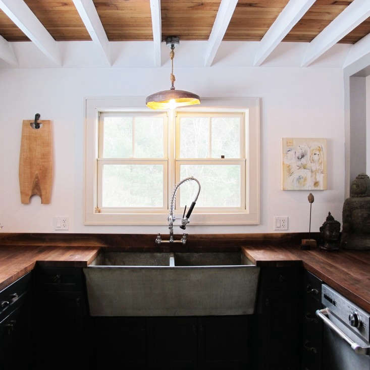 a u shaped kitchen takes up half of the back wall of a house in ulster county,  18