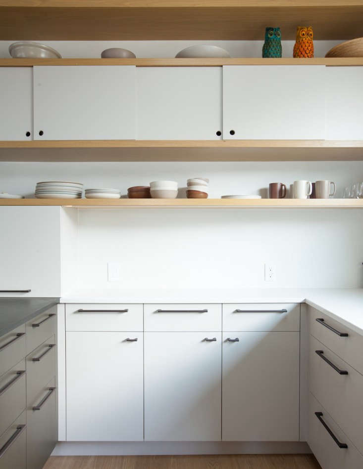 In Kitchen of the Week: Oakland Family Kitchen by Medium Plenty, overhead sliding cabinets feature easy-access circular cutouts.