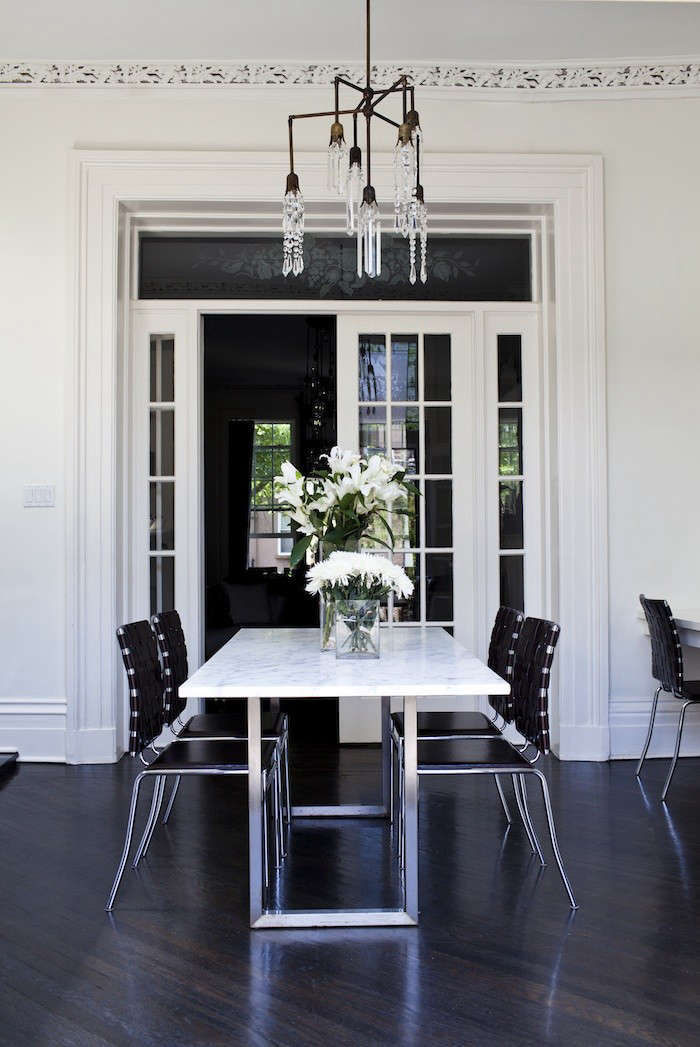 Wood floors with a dark, almost black ebonized look; seeAt Home with a Brooklyn Fashionista Turned Lighting Designer.