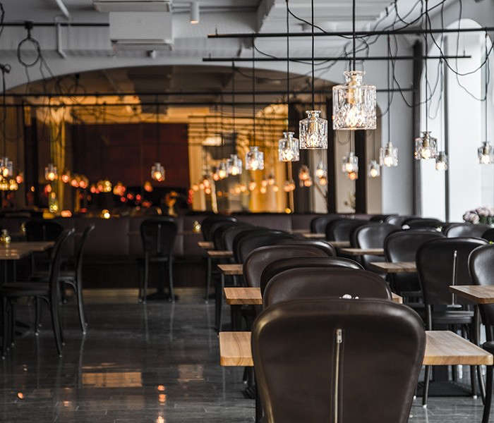 The hotel restaurant is illuminated by a metal framework of cut-glass pendant lights.