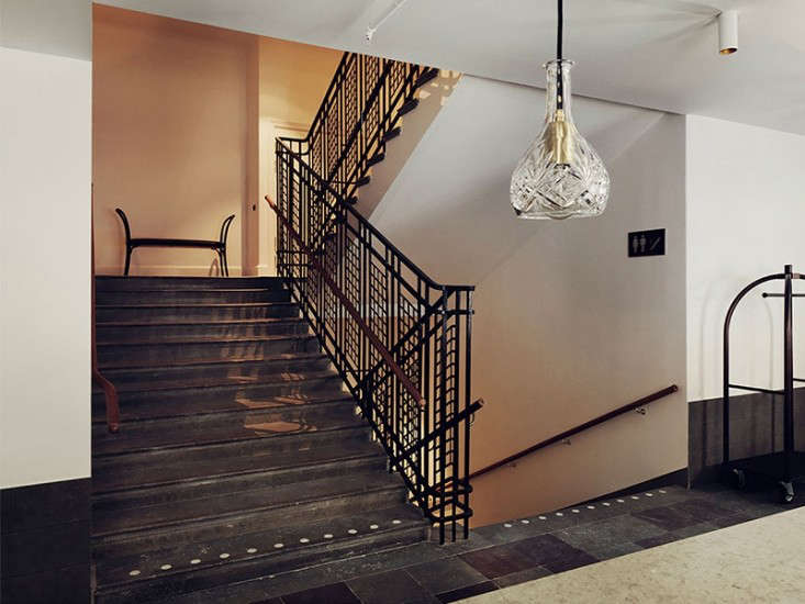 An open metal stair rail with a distinctive Art Nouveau pattern is decorative as well as functional.