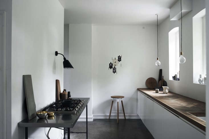 In his own kitchen, Jonas Bjerre-Poulsen, a partner in the Copenhagen firm Norm Architects, installed a cooktop set into a workbench for a sense of airiness. Photo from Expert Advice: Monochrome for the Minimalist (and Maximalist).