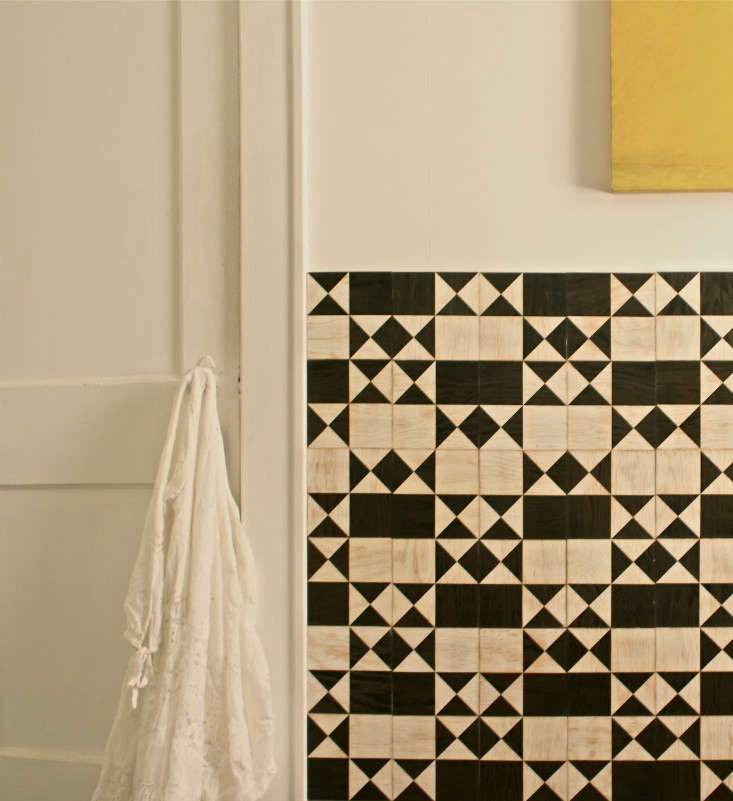 For tired walls or ugly tile, invest in removable tiles that can be stuck or snapped on (and travel with you when you go). We like theseTiles for Commitment Phobes, shown here in a bathroom in apolyurethane finish (for use in moist areas).