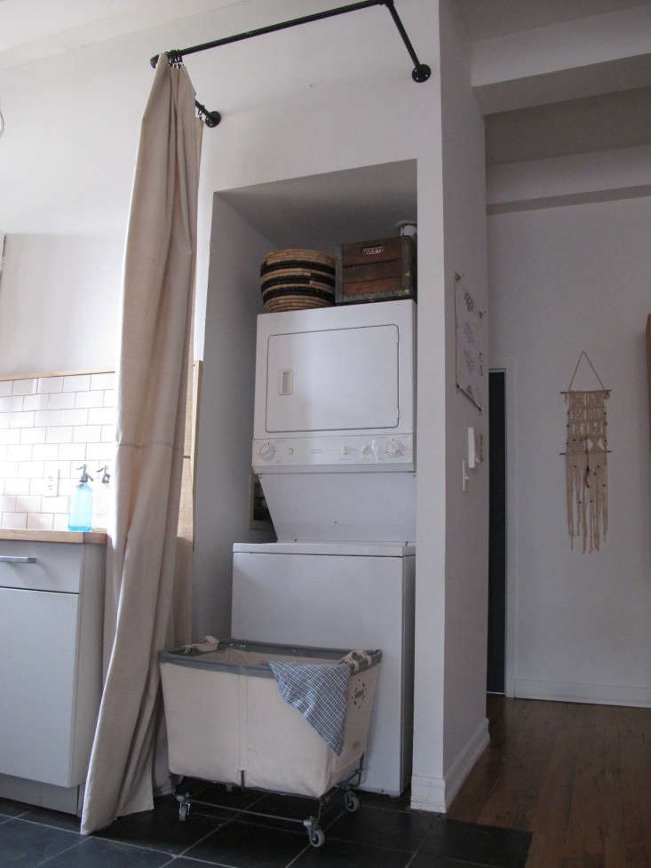 How to turn a tiny washer-dryer nook into a functional laundry space? Add a generous curtain rod, rolling cart, and storage baskets. For instructions, see DIY: The $65 Laundry Closet, Renter's Edition.