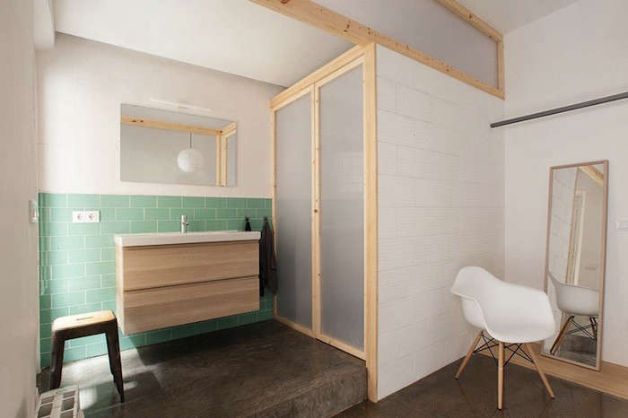 A budget bath in Barcelona features an Ikea vanity and cheery green tiles. Photograph via Nook Architects, from Design Sleuth: Ikea Vanity Installed by Nook Architects.