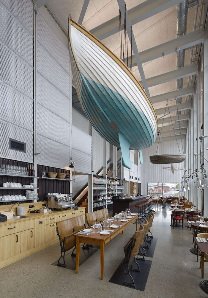 The interior of Slip, also known as the bistro, is filled with marine references, including boats hanging from the rafters. The turquoise-bottomed Tova, a Swedish wooden craft called a plymsnäcka, was built in 05; the single scull at the restaurant&#8