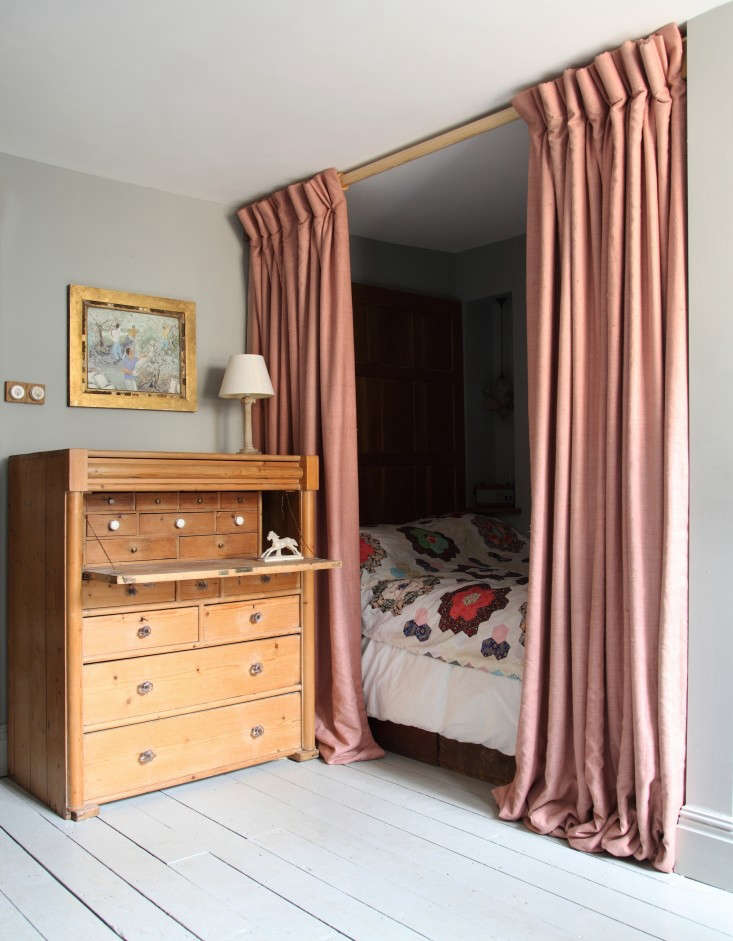 Shut out the light (and create a sleep cocoon) with a curtained bed. Photograph fromOut with the New: Reinventing the Past in a London Remodel.