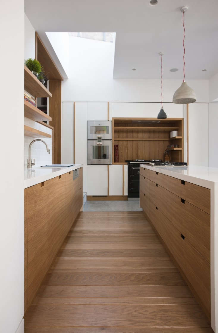 A Dublin kitchen by architect Peter Legge, who used self-closing drawers with rectangular cutouts in lieu of drawer handles. Photograph by Sean Breithaupt and Yvette Monohan.