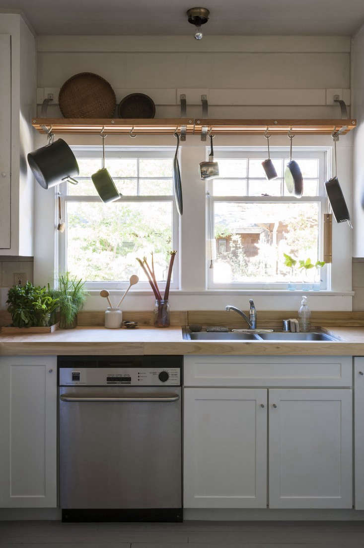 Another countertop cover-up: Sarah Lonsdale had plywood covers cut to fit over the existing countertops in her West Coast rental. When she moves out, they can be easily lifted off and packed away. See Sarah's Refined Rental in St. Helena, CAfor more.