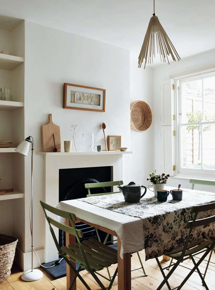 Interior shutters, rather than curtains, keepa petite dining room uncluttered. For more, seeRequired Reading: Beautifully Small.